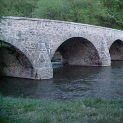 Old three arch stone bridge